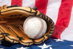 Baseball and glove on American flag