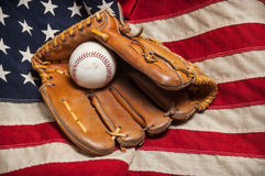 Baseball glove on an American flag Stock Photos