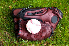 Baseball glove and ball Stock Photos