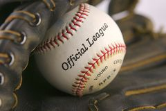 Baseball Glove with Ball. Baseball in Leather Mitt with soft background Royalty Free Stock Images