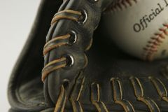 Baseball Glove with ball. Threads and stitching showing Royalty Free Stock Photo