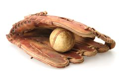 Baseball Glove and Ball. Baseball inside pocket of fielders mitt glove and ball Royalty Free Stock Photography