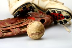 Baseball Glove and Ball. Baseball glove shoes and bat ready for the ball game Stock Images