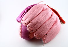 Pink baseball glove and ball. Pink baseball glove of mitt holding ball, white studio background royalty free stock image