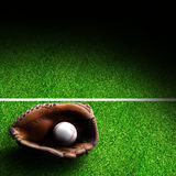 Baseball Glove and Ball on Field With Copy Space Stock Photo