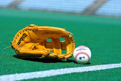 Baseball glove and ball on the field Stock Image