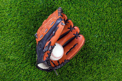 Baseball glove and ball on grass Royalty Free Stock Images
