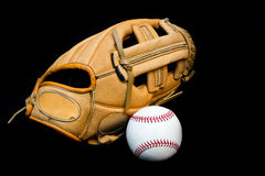 Baseball glove and ball. Leather baseball glove and ball on black background Royalty Free Stock Photos