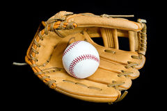 Baseball glove and ball. Leather baseball glove and ball on black background Royalty Free Stock Photography