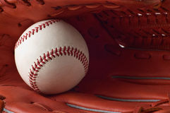 A baseball glove and ball on white background. Ball and glove,tools of baseball Stock Photo