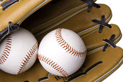 Baseball glove and balls. A baseball glove and two baseballs on white stock photography