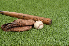 Baseball with glove and bat. On grass Royalty Free Stock Images