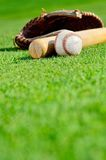 Baseball with glove and bat royalty free stock photography
