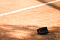 Baseball glove in the field stock photography
