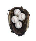 Baseball Glove with Four Baseballs. Stock Photography