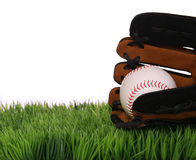 Baseball in Glove on Green Grass, isolated Royalty Free Stock Photo