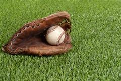 Baseball glove and hard ball Royalty Free Stock Photo