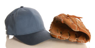 Baseball glove and hat Stock Image