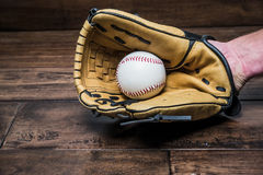 Baseball glove on his hand with the ball Stock Photo