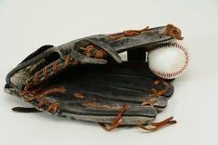 Baseball glove holding baseball stock images
