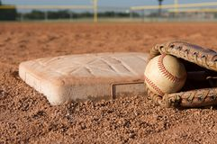 Baseball in a Glove near the base Royalty Free Stock Images