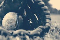Baseball in glove Stock Photos