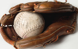 Baseball glove. Old worn baseball glove and ball Royalty Free Stock Photo