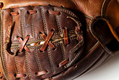 Baseball glove. Old worn baseball glove and ball Royalty Free Stock Images