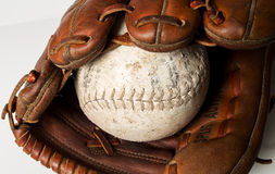 Baseball glove. Old worn baseball glove and ball Stock Photos