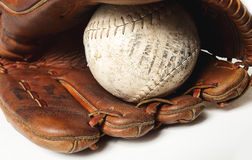 Baseball glove. Old worn baseball glove and ball Stock Photo