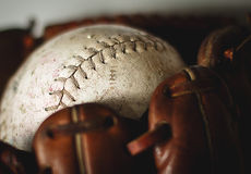 Baseball glove. Old worn baseball glove and ball Stock Image