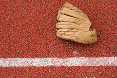 Baseball glove on rubber background Royalty Free Stock Image