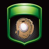Baseball in glove in shiny green frame Royalty Free Stock Images