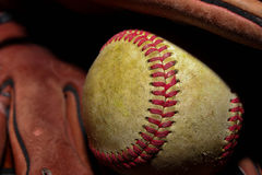 Baseball in a glove. A used baseball resting in a glove Royalty Free Stock Photo
