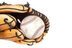 Baseball and glove on white background. A baseball and baseball glove sports theme on a white background Royalty Free Stock Images