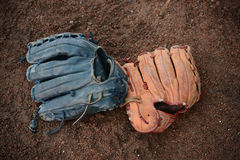 Baseball gloves. On the ground royalty free stock image
