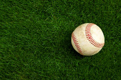Baseball on grass. Old baseball on grass background Royalty Free Stock Photo
