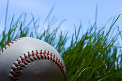 Baseball, grass and blue sky Royalty Free Stock Photos