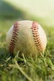 Baseball on grass (close-up) Royalty Free Stock Photos