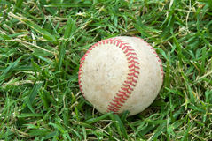 Baseball on grass field Stock Photos