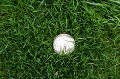 Baseball in grass Royalty Free Stock Photos