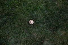 Baseball in grass Royalty Free Stock Photography