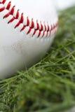 Baseball in Grass Macro. Angled macro shot of smudged baseball in grass Royalty Free Stock Photography