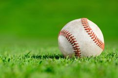 Baseball in grassy field Royalty Free Stock Images