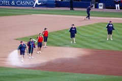 Baseball - Grounds Crew Watering the Field Stock Images