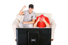 Baseball: Guys Rooting For Different Teams. Isolated on white series of two men in baseball uniforms, in various poses with props Stock Photos