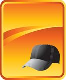 Baseball hat on gold background Royalty Free Stock Photography