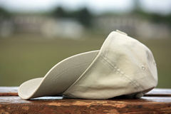 Baseball hat on wooden Royalty Free Stock Photos