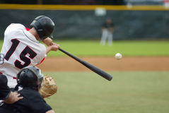 Baseball Hit!. Baseball player number 15 connecting with baseball, bat extended, ball in front Royalty Free Stock Photo