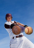 Baseball hit. A baseball player taking a swing at a baseball Stock Image